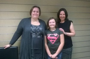 Delighted client Sarah Whittle and her daughter, Amy, met with solicitor Sue Robinson at our offices.